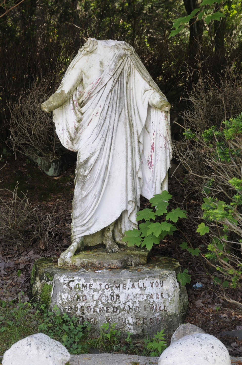 A statue of Jesus, was placed at the entrance to Holy Land. It has since been vandalized and is deteriorating.