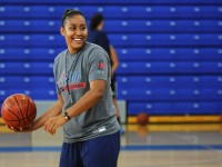 UConn basketball player, Kaleena Mosqueda-Lewis looks to make a pass as she coaches at the Kara Wolters Dream Big Basketball Camp for girls at Avon High School.