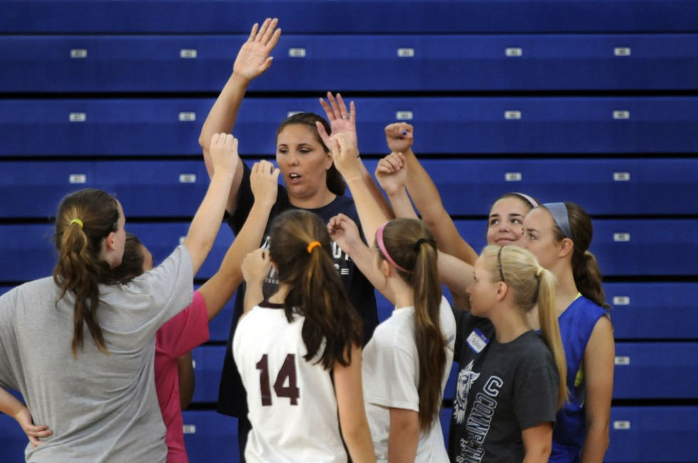 Kara Wolters holds a huddle during the Kara Wolters Dream Big Basketball Camp for girls at Avon High School. The camp for girls in grades 6 through 11 is one of two sessions Walters holds annually.