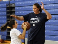 Former UConn basketball player Kara Wolters plays defense as she coaches Serene Gherri, 13, of Rocky Hill, on an inside move during the Kara Wolters Dream Big Basketball Camp for girls held at Avon High School.