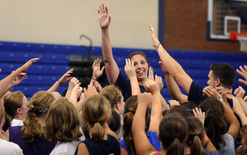 Former UConn basketball player Kara Wolters ends Tuesday's Kara Wolters Dream Big Basketball Camp for girls held at Avon High School, by gathering the girls at center court and doing a really high five.