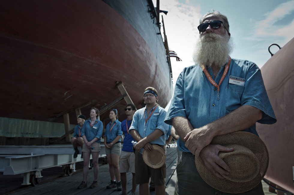2013.07.21 - Mystic, CT - Mystic Seaport staff, including Dean Seder (far right) stand in silence near the hull of the Charles Morgan during the National Anthem and before the ship was set afloat. Photograph by Mark Mirko | mmirko@courant.com