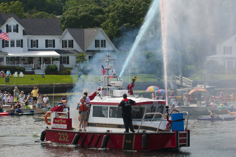 2013.07.21 - Mystic, CT - A Mystic Fire Department ship sprays colored water after the Charles Morgan is set afloat. Photograph by Mark Mirko | mmirko@courant.com