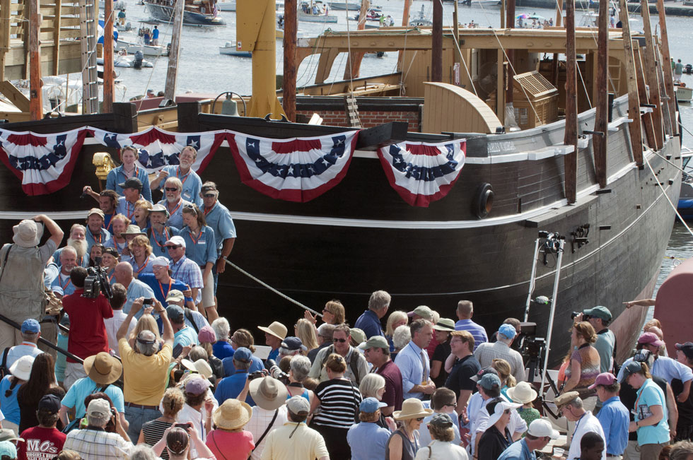 2013.07.21 - Mystic, CT - Crowds gather around the bow of the Charles Morgan after America's oldest commercial vessel and national historic landmark whaleship Charles W. Morgan was set afloat. Photograph by Mark Mirko | mmirko@courant.com