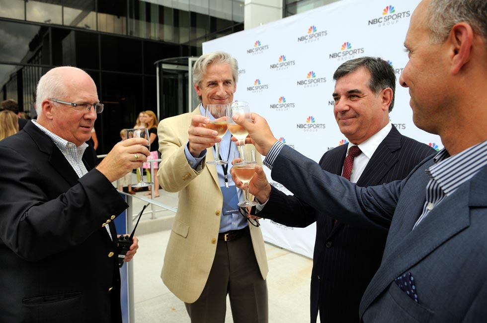 John Fritche, Sr. VP. of Operations at Stamford facility, David Mazza, CTO & SVP of NBC Sports Group and Olympics, Stamford Mayor Michael Pavia, and Rob Landau, Sr. VP NBC Sports Group, toast to the success of the new NBC Sports Group facility.