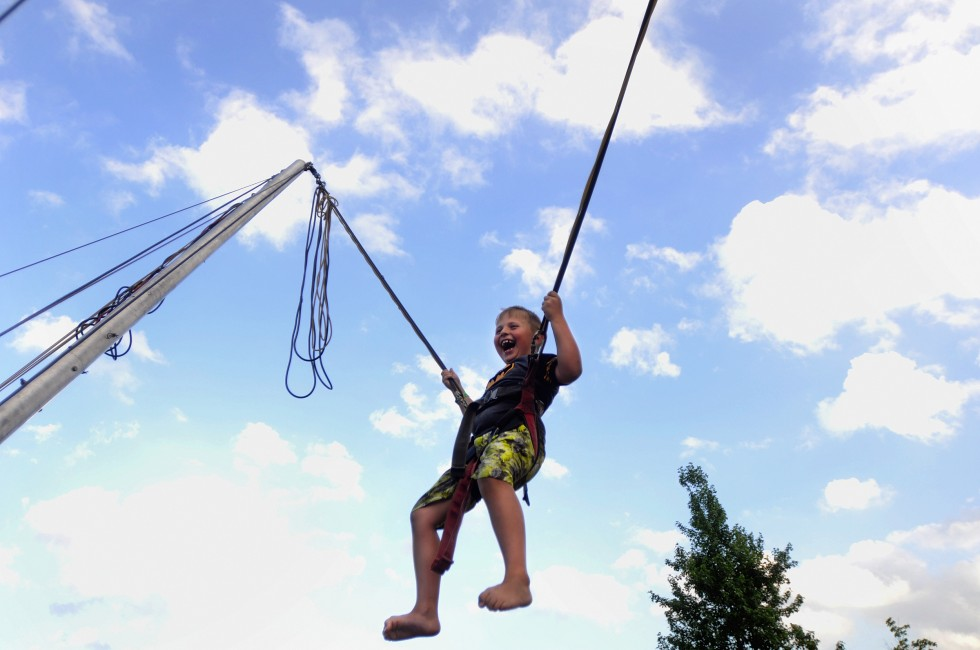 Abraham Pecarevic, 6, of New Britain, yells out as he reaches new heights at an attraction sponsored by the city of New Britain.