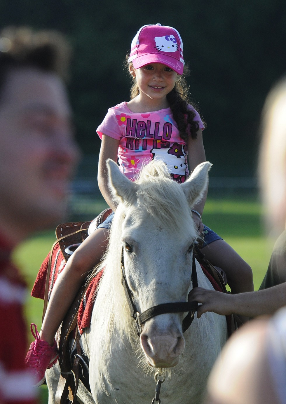Haylee J. Rivera, 4, of New Britain, enjoys a pony ride available at the event. Rivera was at the park with her father and siblings.