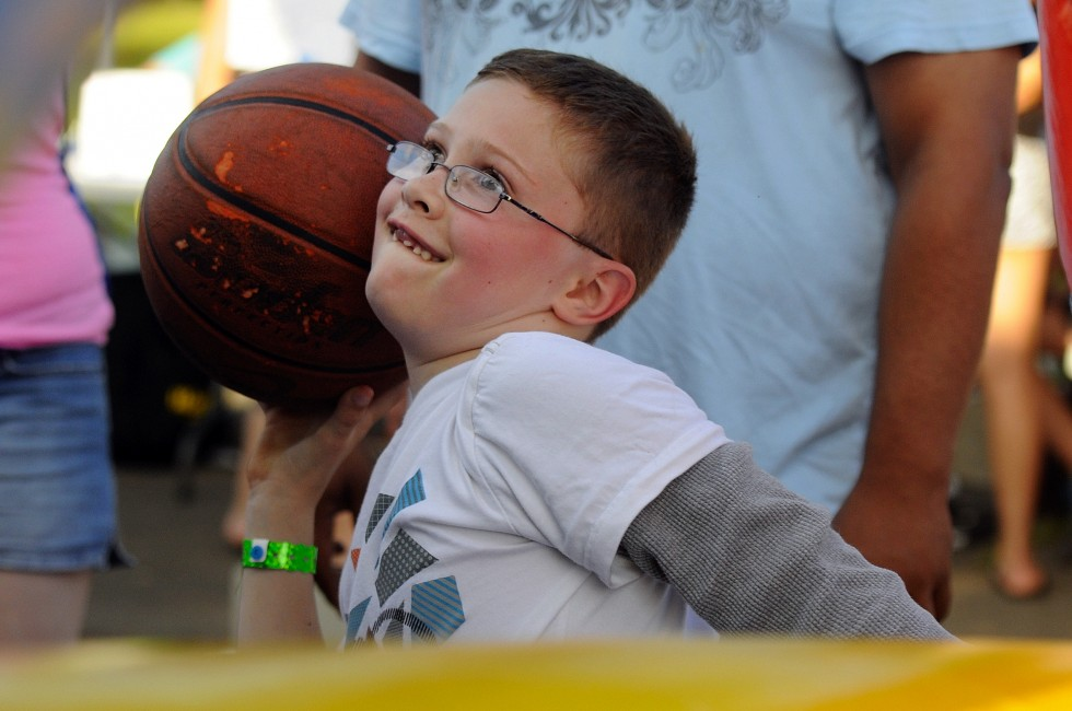 Dominic Sedlac, 8, of New Britain, takes a shot at the Full Court Press amusement attraction.