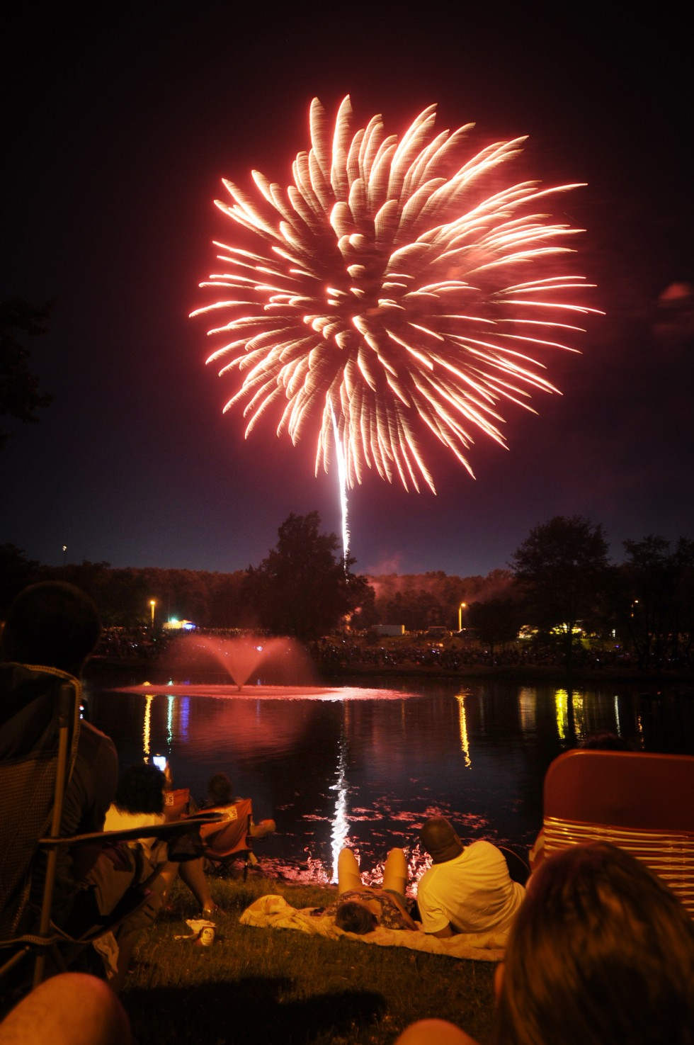 Fireworks capped the night festivities. Viewers lined the trails and pond to watch the fireworks.