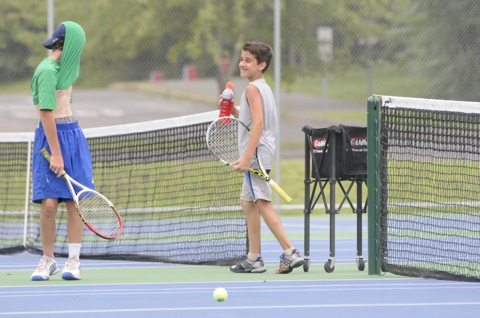 Henry Murphy, 12, of Wilton, left, and Alex Chaho, 10, of Avon, take a break in practice.