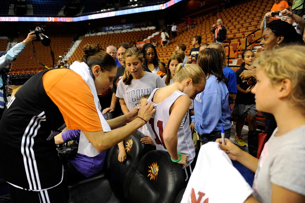 Diana Taurasi was also more than happy to sign jerseys, hats, and posters for many of the fans that attended the event.