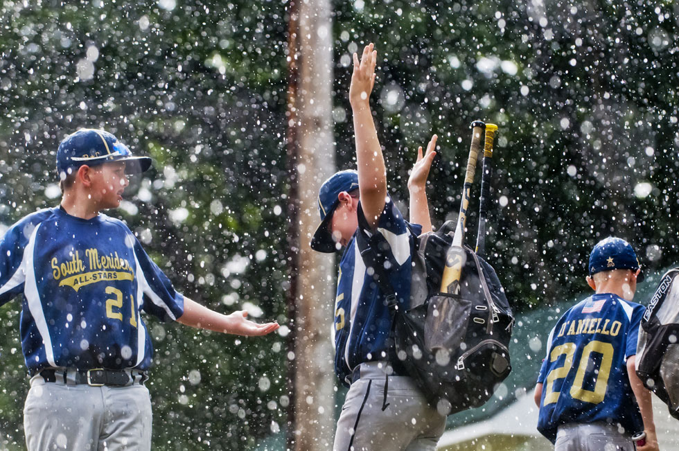 2013.07.23 - West Hartford, CT - (L-R) Brian Carabetta and Sean Dupuis of South Meriden react to a sudden downpour Tuesday afternoon at Wolcott Park while getting ready to play in the Cal Ripken State Tournament series against Danbury. The tournamentfeatures seven teams: West Hartford, South Meriden, New Milford, Bethel, Newtown, Oxford, and Danbury. The championship game is slated for Thursday with winner going to West Warwick, RI, for the Regional Championship. Photograph by Mark Mirko | mmirko@courant.com