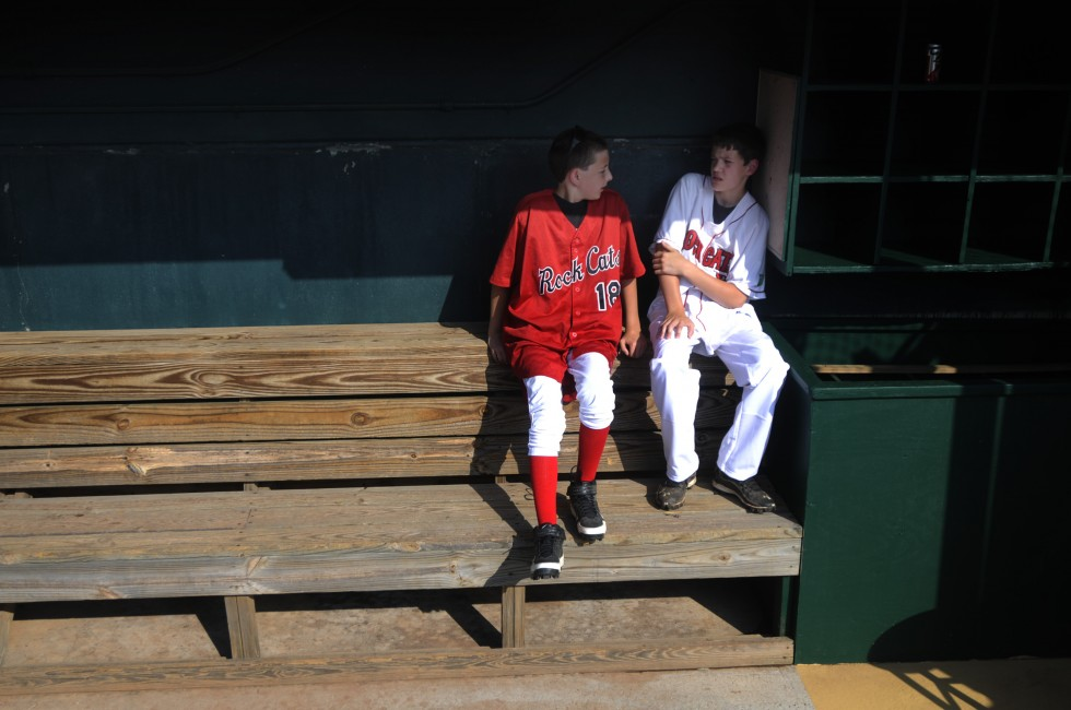 Matt Pattison, 14 left, and his brother Mike, 16, of Southington, sit in the Rock Cats dugout before the home run derby. The boys were helping return balls and bats during the festivities.