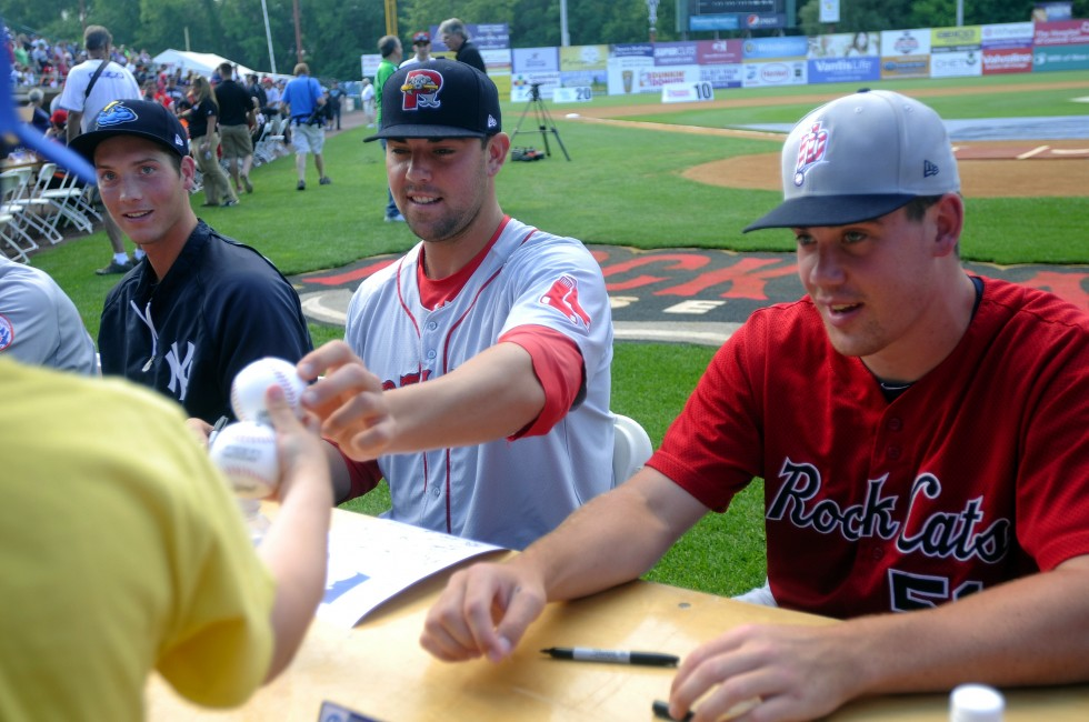 From left, Nik Turley, of the Albany Yankees, Anthony Ranaudo, of the Portland Red Sox, and Trevor May, of the Rock Cats, sign autographs before the home run derby. Ranaudo was scheduled to start the All Star game Wednesday night.