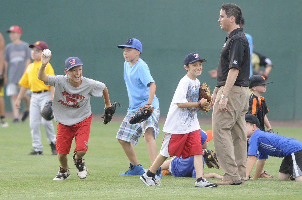 Jake Talbot, 11, of Wolcott, reacts after catching a ball in the outfield during the home run derby.