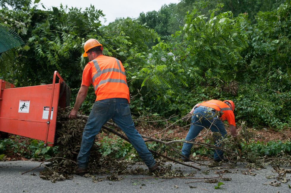 2013.07.11 - Coventry, CT - Workers from the Coventry Department of Public Works clear brush from High Street in Coventry on Thursday after a possible tornado ripped through the area on Wednesday evening. Photograph by Will Parson | wparson@courant.com