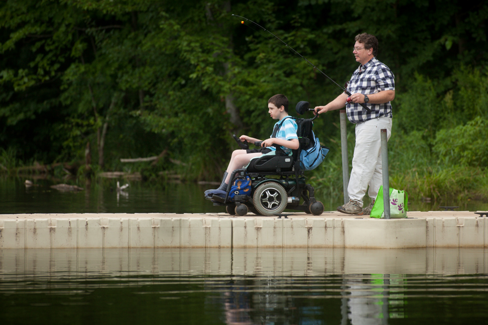 2013.07.28 - Southington, CT - Jesse  Freeman, 10, of Southington rides out on the  dock with his stepfather Brian Hinton. Photograph by Will Parson | wparson@courant.com