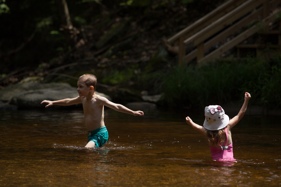2013.07.15 - Granby, CT - Xavier Kahn, 5, and his sister Sadie Kahn, 2, find a quieter area of the brook. Photograph by Will Parson | wparson@courant.com