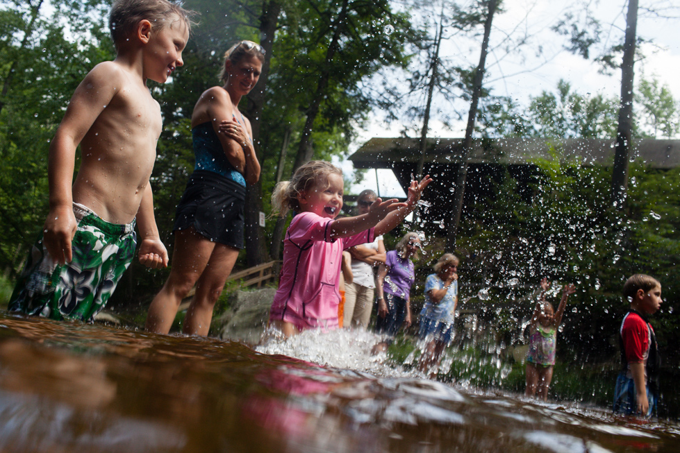 2013.07.15 - Granby, CT - Lauren Allard and her brother Stuart Allard (left) of West Granby take turns splashing water in a stream at Granby Tennis Club on Monday. Temperatures reached the 90s in the area. Photograph by Will Parson | wparson@courant.com