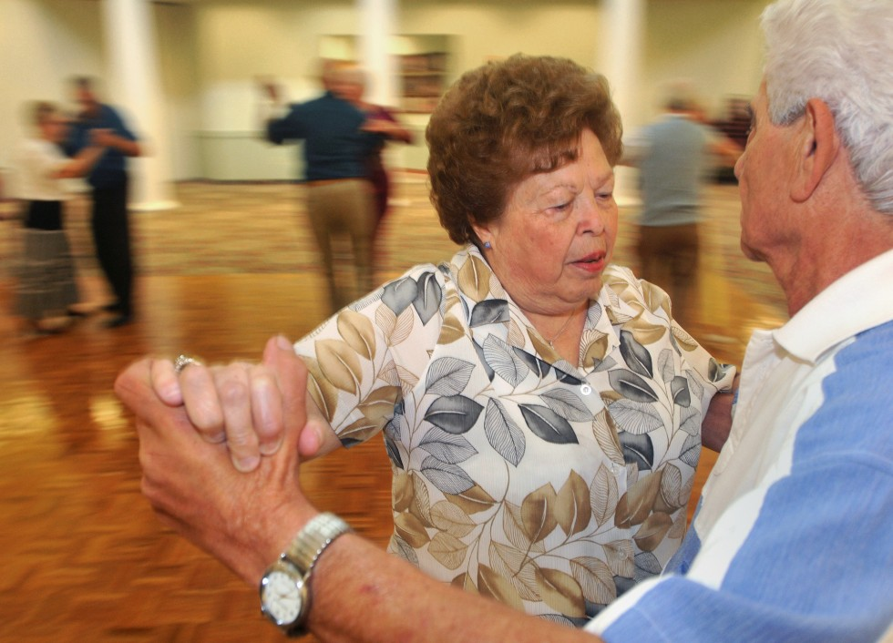 2013.07.26 – Enfield, CT – Mena Ronghi dances with her husband Mario Ronghi at the Enfield Senior Center's monthly ballroom dance. The Ronghis have been married for 60 years and are West Springfield residents. Photograph by Brad Horrigan | bhorrigan@courant.com