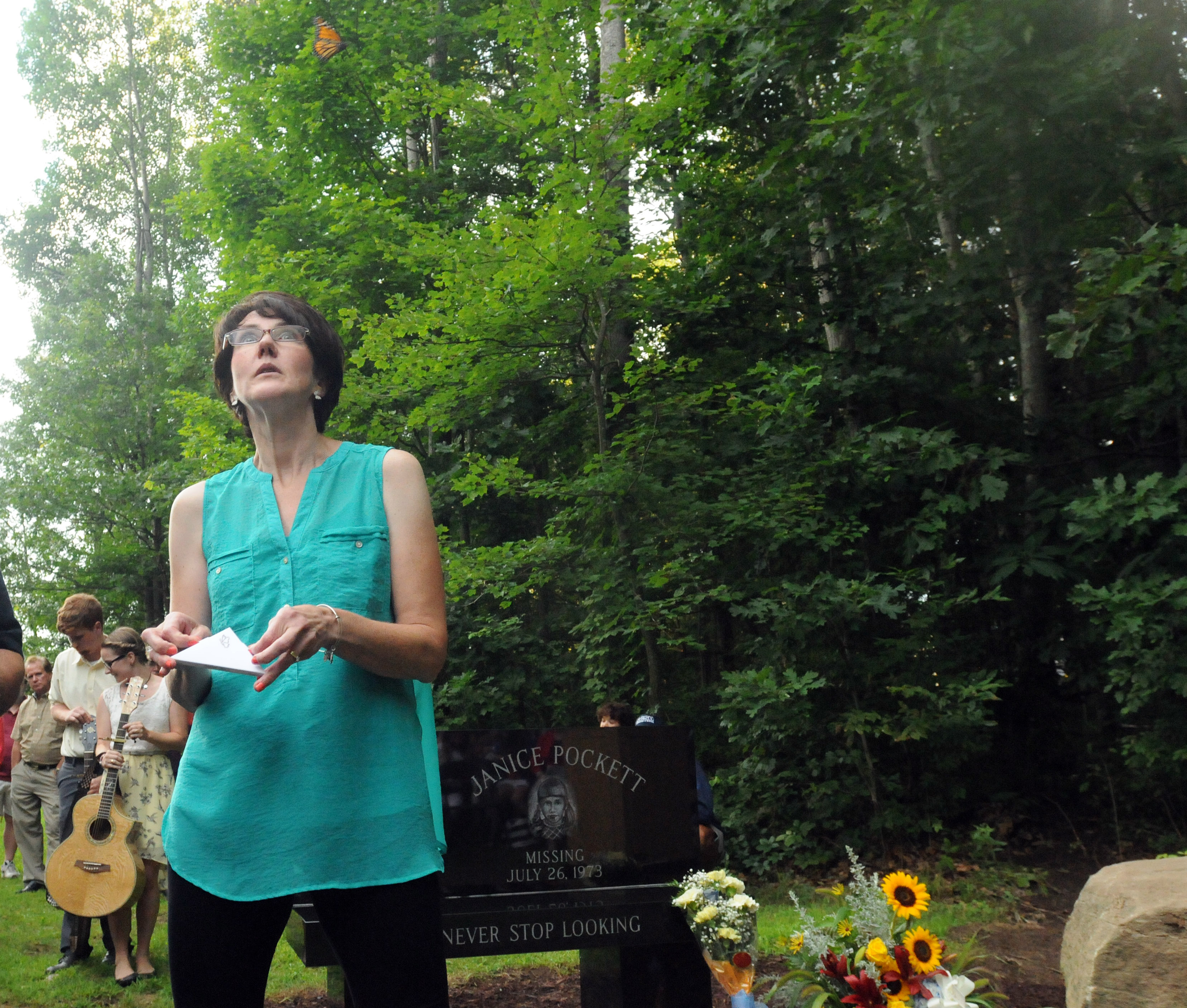 Janice Pockett's sister, Mary Engelbrecht, watches a butterfly rise into the air