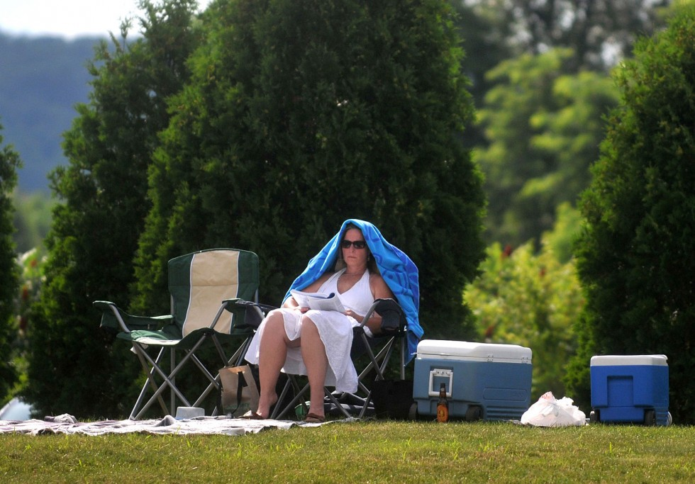 Windsor - 07/06/13 - A lawn spectator tries to stay out of the sun on in between sets at the 2013 Windsor Jazz Jam at SummerWind Performing Arts Center in Windsor. BRAD HORRIGAN | bhorrigan@courant.com