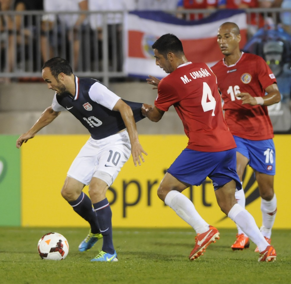 Landon, Donovan, 10, of the United States, his held by Michale Umana, 4, of Cost Rica in the second half.
