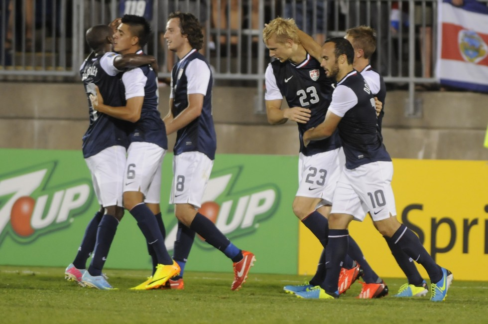 Landon, Donovan, 10, of the United States, congratulates his team Brek Shea, 23, of the United States after he scored a goal on an assist by Donovan.