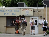 Micah Welintukonis, second from right, and his supporters an American Legion in Hartford along the way, however, they found the post closed when they arrived.