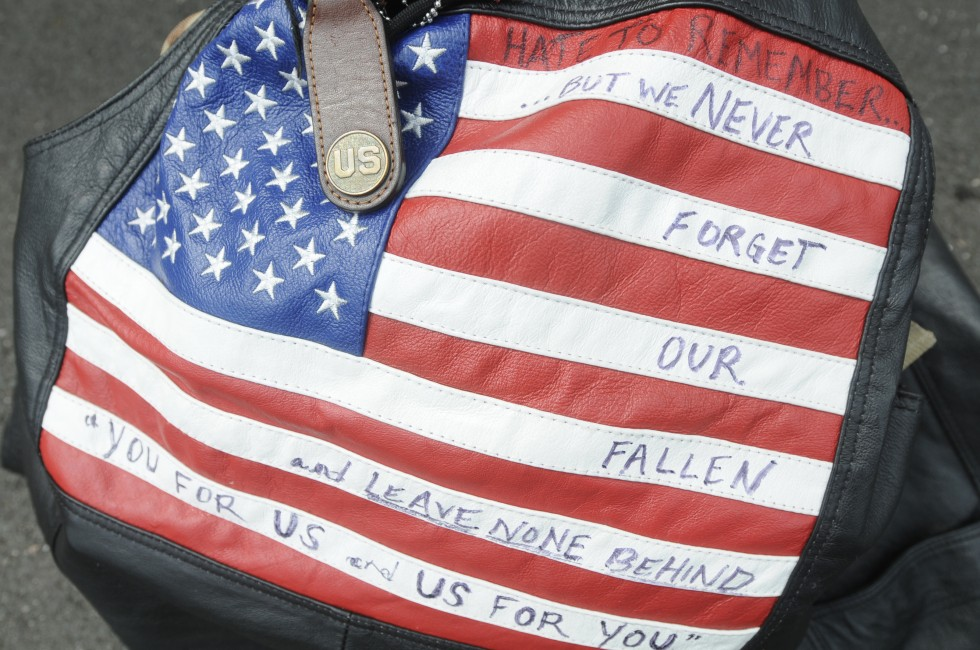 The vest and backpack of Iraq veteran Matt McDonald, of Weathersfield, rests on the pavement during a rest stop along the route. McDonald did not know Welintukonis prior to this fund raising event, but said he joined the walk to support wounded veterans like himself.