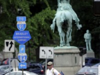 Micah Welintukonis walks past the Marquis de Lafayette on Lafayette Circle on Washington Street in Hartford Thursday afternoon.