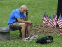 Former Windsor police officer and green beret Vietnam veteran Carl Thomas, of Manchester, takes a break at a Vietnam memorial on New Britain Ave. in Hartford. Thomas was a mentor Welintukonis when he was a boy.