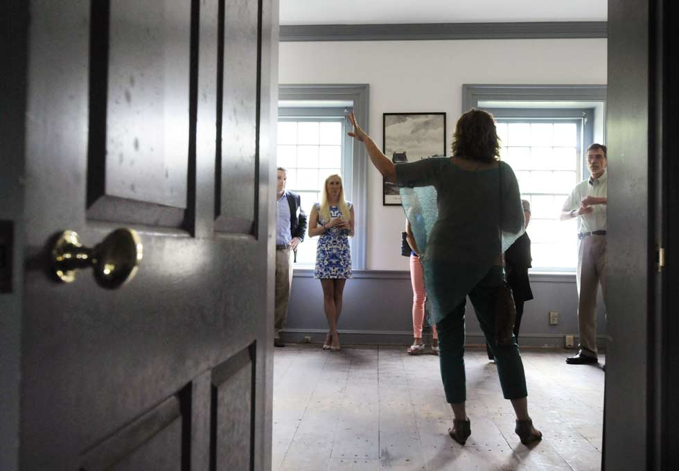 Visitors tour the Amos Bull House in Hartford where Connecticut Landmarks will have their offices and a community education center after renovations are completed in December.  The Amos Bull House on Prospects Street in Hartford is one of four 18th century buildings in Hartford. Amos Bull, a dry goods merchant, used the 1st floor for his business and lived on the top two floors. The building was modified and moved twice.  Over the years the building was a hardware store, auto dealership, and insurance offices.