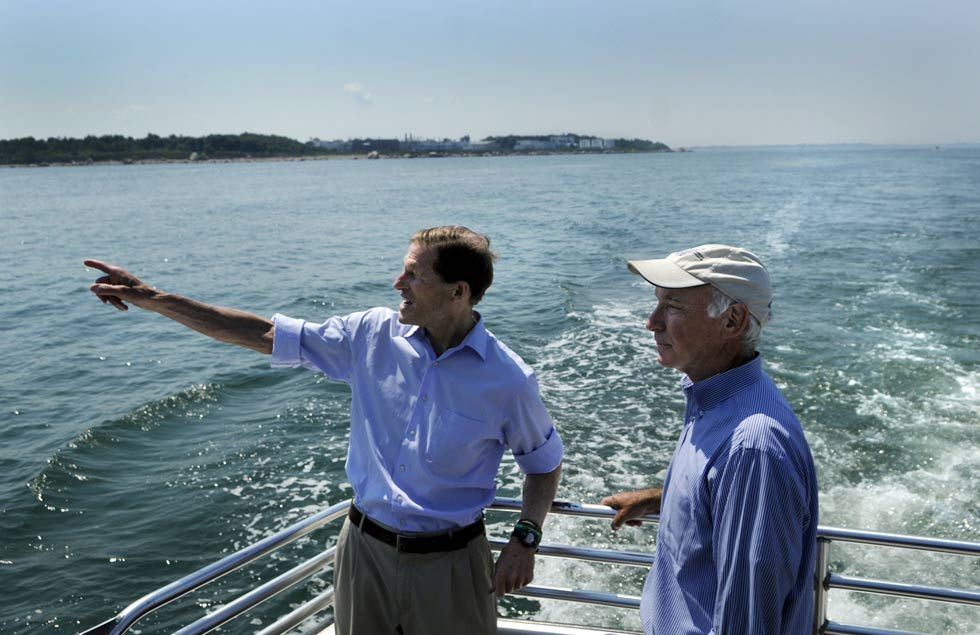 Senator Richard Blumenthal, left,  and Rep. Joe Courtney look out at Plum Island.
