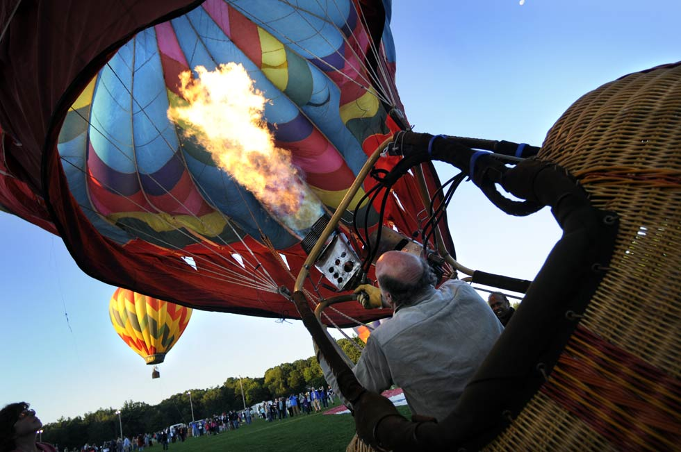Robert Zirpolo of Plainville, a veteran balloonist of 30 years, fills his balloon with hot air in preparation for take-off Saturday morning.
