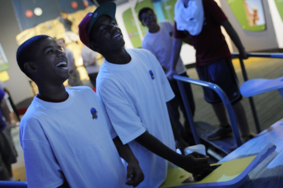 Gabe Navarro, 12, left, and Isaiah Wallace, 14, both of New Britain, laugh as they play a game called BorderCross in the MathAlive! exhibit at the Science Center in Hartford. Navarro is a student at Diloreto Magnet School in New Britain and Wallace is a student at Annie Fisher Magnet School in Hartford. The game teaches angles and precision balance in the form of a ski race.