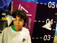Emmanuel Gonzalez, 11, with the Waterbury CPEP program, watches to see how a paper cone cup, which he had earlier cut with scissors, flies while being blown by a fam. The exhibit, titled Altitude (AGL), was in the Forces in Motion exhibit at the Science Center in Hartford.