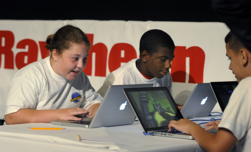 From left, Victoria Farrell, 13, Isaiah Wallace, 14, and Nick Makuch, 12, all with the CPEP program out of New Britain, play a math skills game called Dimension M, in a competition with a children from Waterbury in the auditorium at the science Center in Hartford.