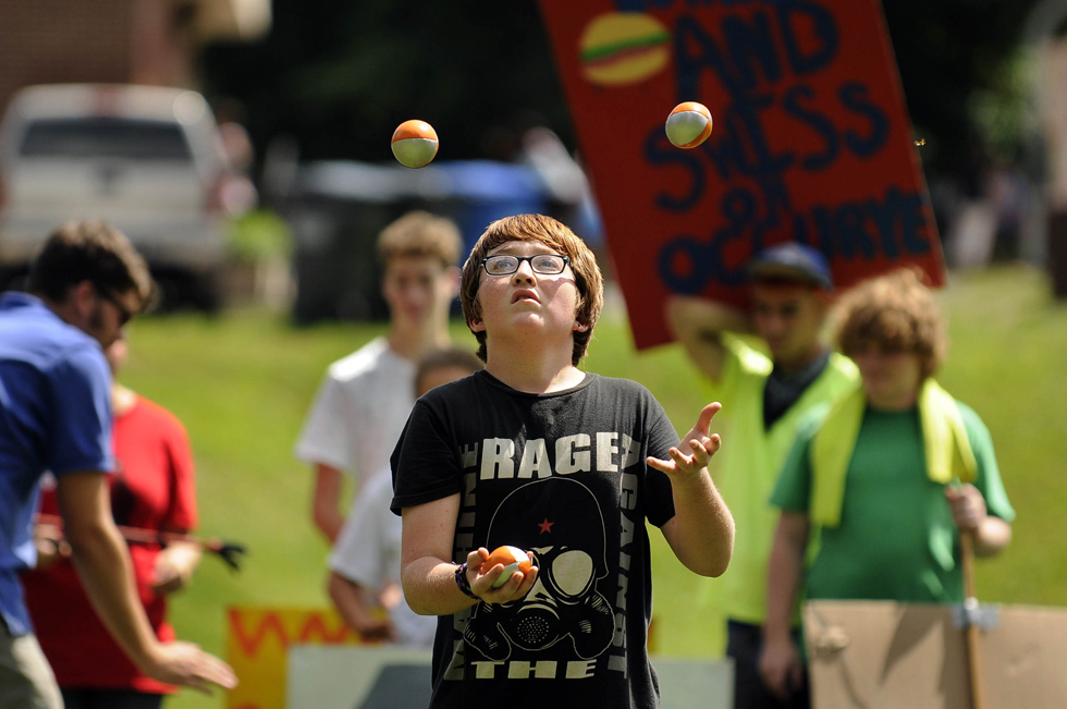 "Kadin Eason, 13, of Middletown, practices his juggling act during a rehearsal of the Big City Circus  at Macdonough School.  Eason is taking part in the program for the first time this summer and loves the team-building aspect of the circus.  ""It's awesome!"" he said."