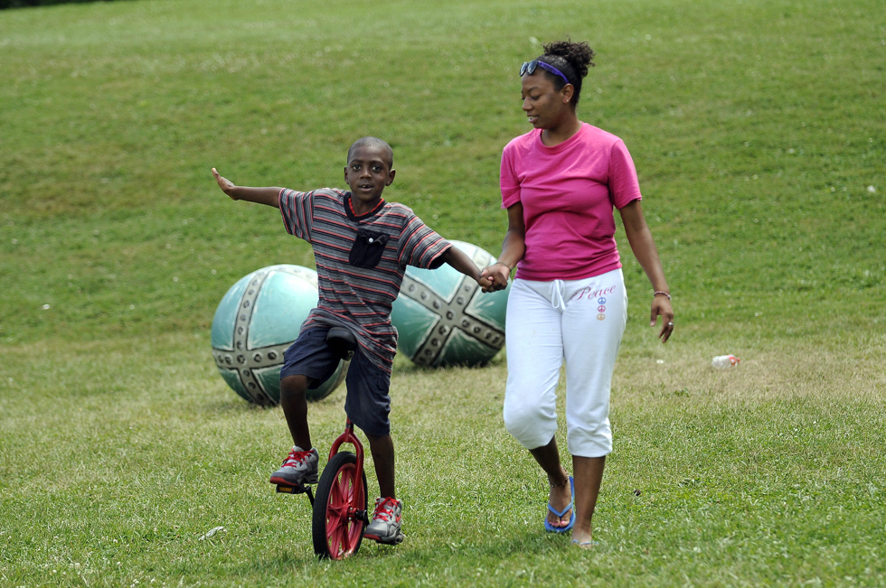 Counselor Mariah Perry, of Middletown, (right) steadies Sa-cario Freeman, 8, (cq) also of Middletown, as he practices the unicycle during a rehearsal for the  Big City Circus.