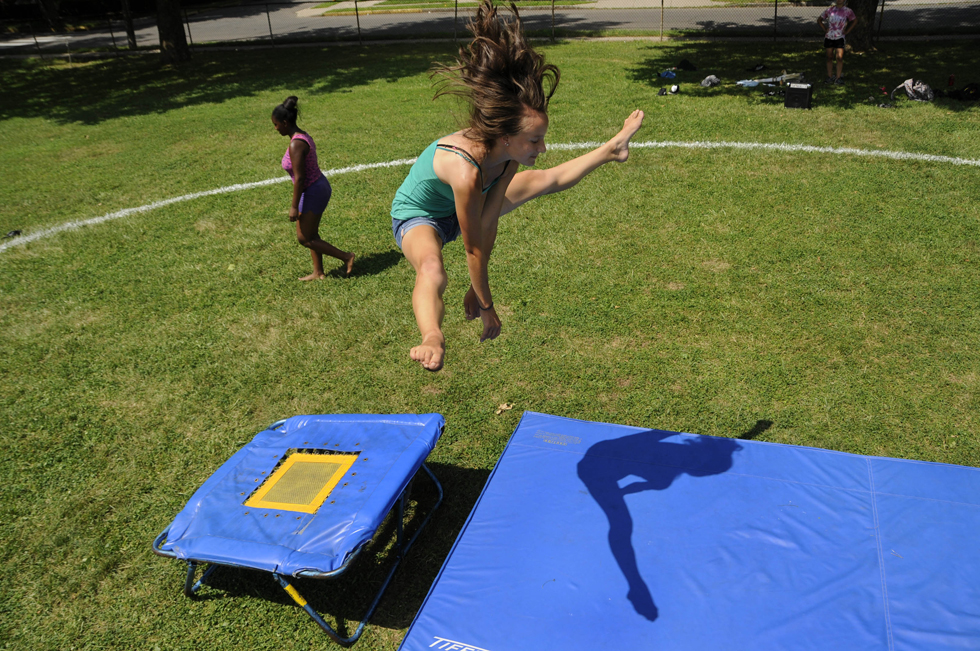 Abby Rancourt, 14, of Middletown, practices acrobatics with a mini trampoline during rehearsal. Rancourt, who has been taking part in the circus program for four years, is one of the advance performers.