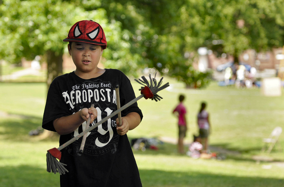 Jayden McClanahan, 8, of Middletown, practices the devil sticks during circus rehearsal. Of all the skills the campers get to try out during the five-week program, juggling is McClanahan's favorite.