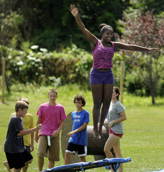Victoria Bomani, 13, of Middletown, goes airborn off a trampoline while rehearsing with the advanced circus performers.  This is Bomani's sixth year with the circus.