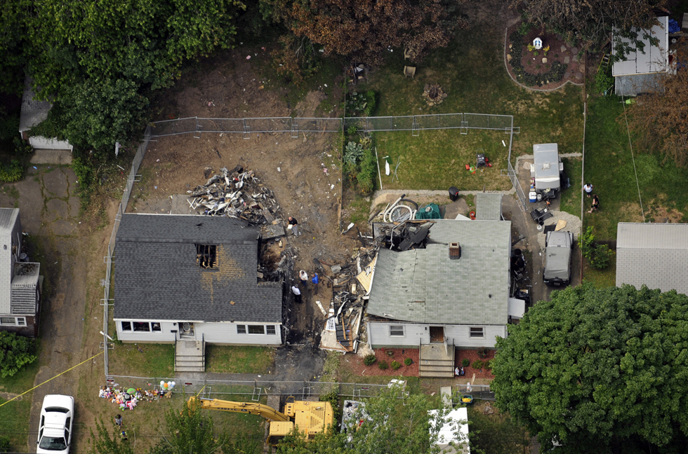 2013.08.12 - East Haven, CT - This aerial view of the site on Charter Oak Avenue in East Haven show where a plane crashed into two houses, killing four people on Friday.  The debris of the plane has been removed.