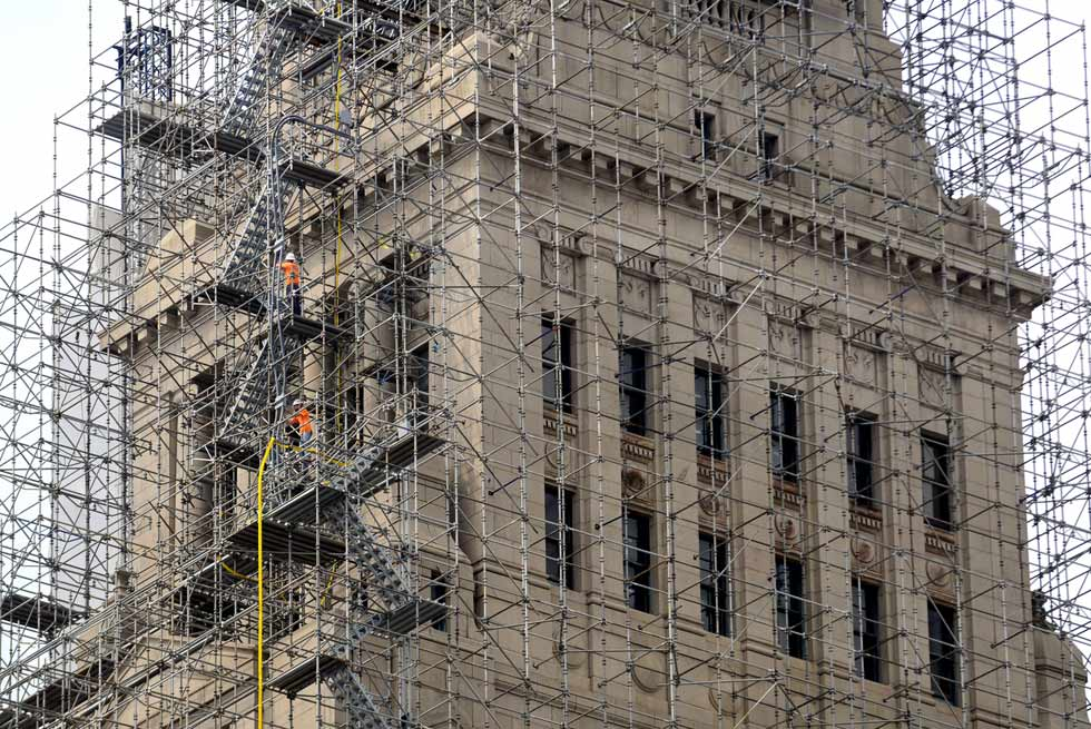 The Travelers Tower, an icon of Hartford's skyline, is completed covered with a complex maze of scaffoldiong as workmen continue with the restoration of the venerable building.