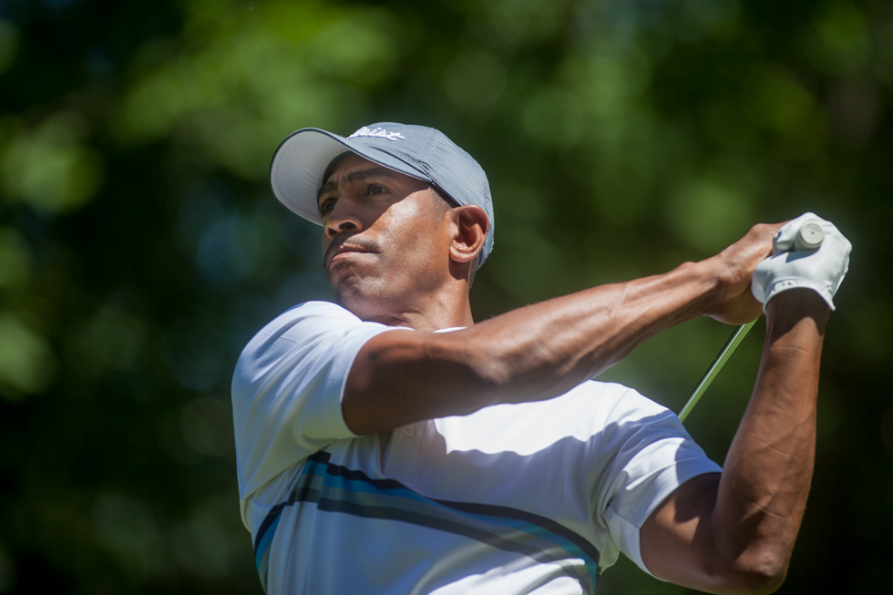 2013.08.05 - Glastonbury, CT - Kevin Ollie tees off on the third hole during the Kevin Ollie Golf Classic at Glastonbury Country Club on Monday. Photograph by Will Parson | wparson@courant.com