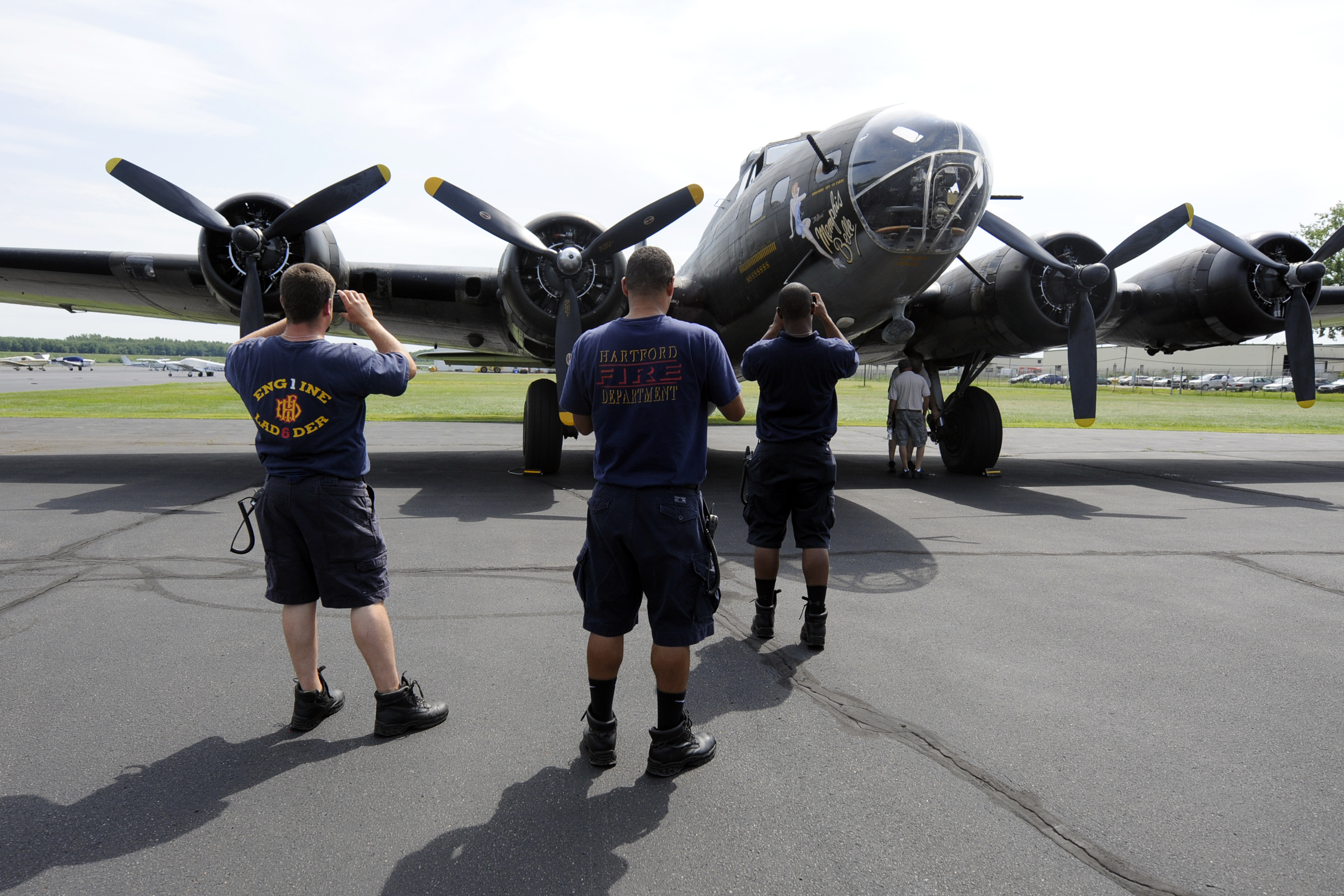 """The B-17 Flying Fortress """"Movie Memphis Belle"""" attracts attention while parked at Brainard Airport in Hartford during a visit to the city Monday."""