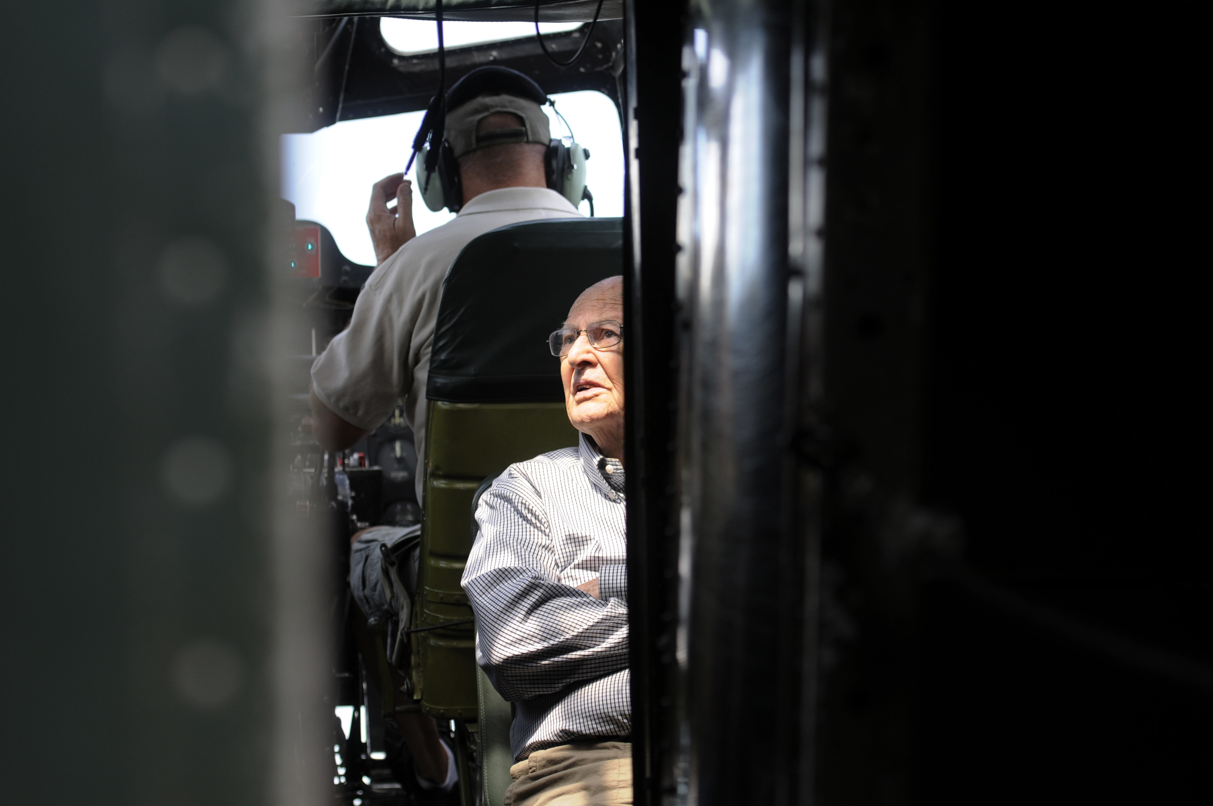Ken Johnson, 87, a former tail gunner in a B-17 Flying Fortress sits behind the co-pilot during a short flight aboard the Memphis Belle, a copy of a World War II bomber that saw service in Europe. For Johnson, the war ended just after he compteted training. He lives in Newtown.