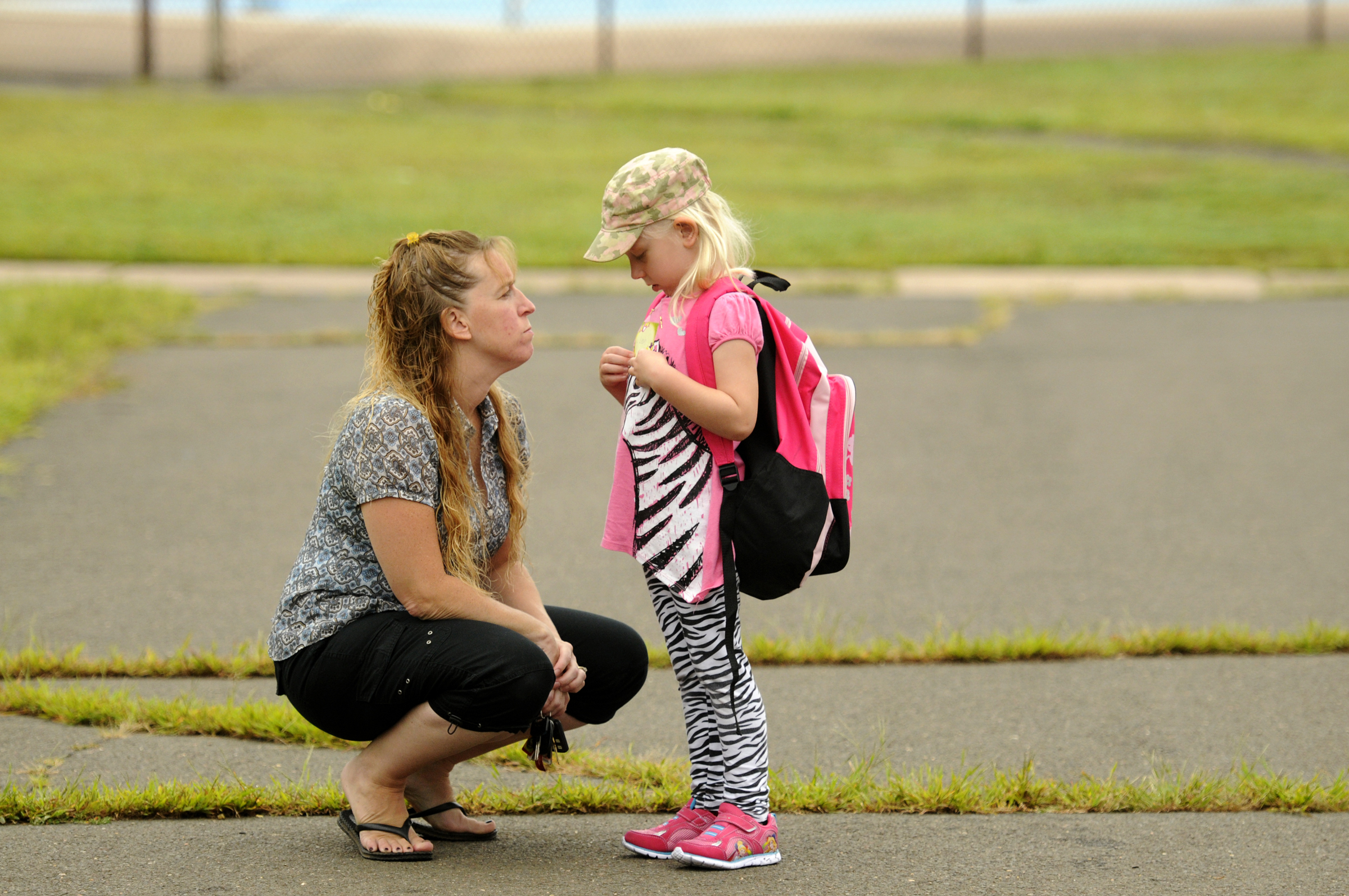 Jill Terry tries to settle some apprehension by her daughter Leah Terry, 5, in the Waddell School playground before the children, escorted by parents, entered for the first day of kindergarten class Wednesday morning.