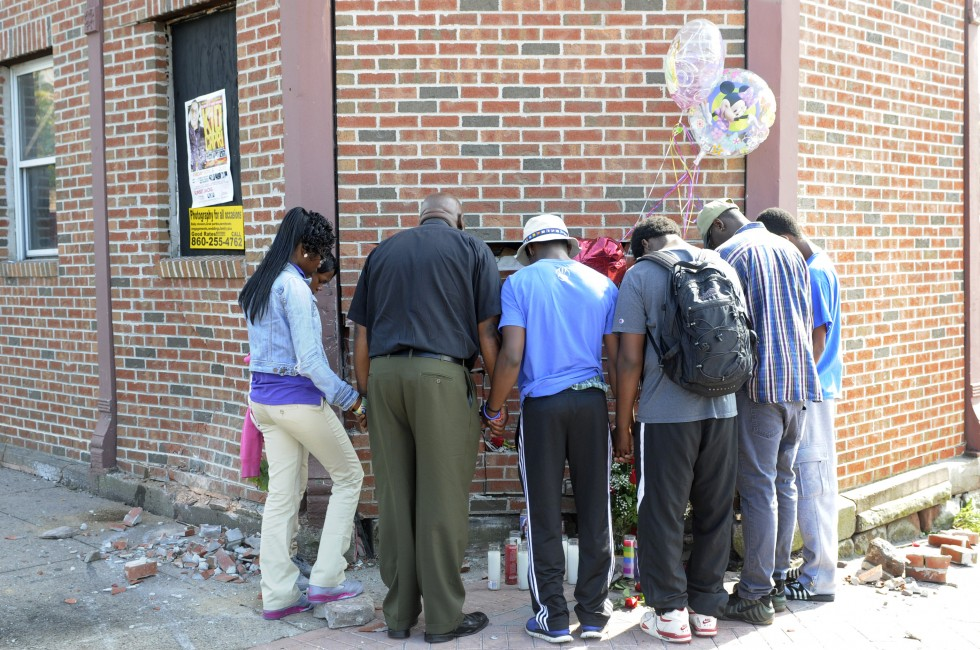 Rev. Henry Brown, of Hartford, led a group of mourning teenagers in prayer at the scene of the accident.